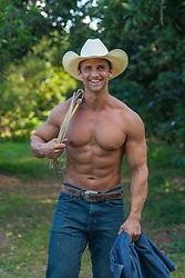 muscular good looking shirtless cowboy smiling