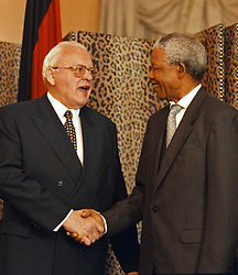 March 10, 1998 - Cape Town, South Africa - NELSON MANDELA, the South African President talks to his guest, German President Dr ROMAN HERZOG, after signing bilateral agreements, at Presidential offices in Cape Town. German President is in a four day official visit to South Africa. (Credit Image: © Sasa Kralj/JiwaFoto/ZUMAPRESS.com)