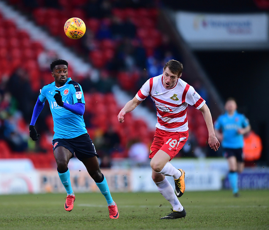 Fleetwood Town's Jordy Hiwula vies for possession with Doncaster Rovers' Tom Anderson<br /> <br /> Photographer Chris Vaughan/CameraSport<br /> <br /> The EFL Sky Bet League One - Doncaster Rovers v Fleetwood Town - Saturday 17th February 2018 - Keepmoat Stadium - Doncaster<br /> <br /> World Copyright © 2018 CameraSport. All rights reserved. 43 Linden Ave. Countesthorpe. Leicester. England. LE8 5PG - Tel: +44 (0) 116 277 4147 - admin@camerasport.com - www.camerasport.com