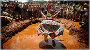 """EAST DUBLIN, GEORGIA - JULY 11: Barbara """"Redneck Queen"""" Bailey shows the crowd the proper way to do the Redneck Bellyflop during the 13th Annual Summer Redneck Games July 11, 2009 in East Dublin, Georgia. Bailey won the event several year running in the 1990s. Started in 1996 as a spoof for the summer Olympics held in Atlanta, the games feature bobbing for pigs feet, hub cap hurling and the Redneck mud pit belly flop contest for trophies. (Photo by Stephen Morton/Getty Images)"""