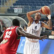 Anadolu Efes's Terence Kinsey (R) during their Turkish Basketball League Play Off match Anadolu Efes between Pinar Karsiyakaat Sinan Erdem Arena in Istanbul, Turkey, Sunday, May 06, 2012. Photo by TURKPIX