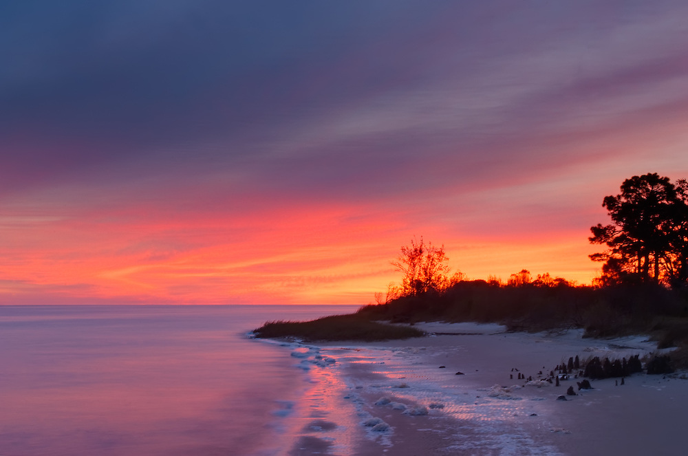 A wildly pink sunrise on a rare below-freezing winter morning over the Ochlockonee Bay on Florida's northern Gulf Coast.