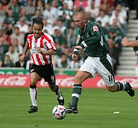 Photo: Lee Earle.<br /> Southampton v Plymouth Argyle. Coca Cola Championship. 24/09/2005. Southampton's Dennis Wise (L) chases Nick Chadwick.