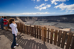 Woman visitor observing Halema`uma`u Crater, Kilauea Caldera, Hawaii Volcanoes National Park, Big Island, Hawaii