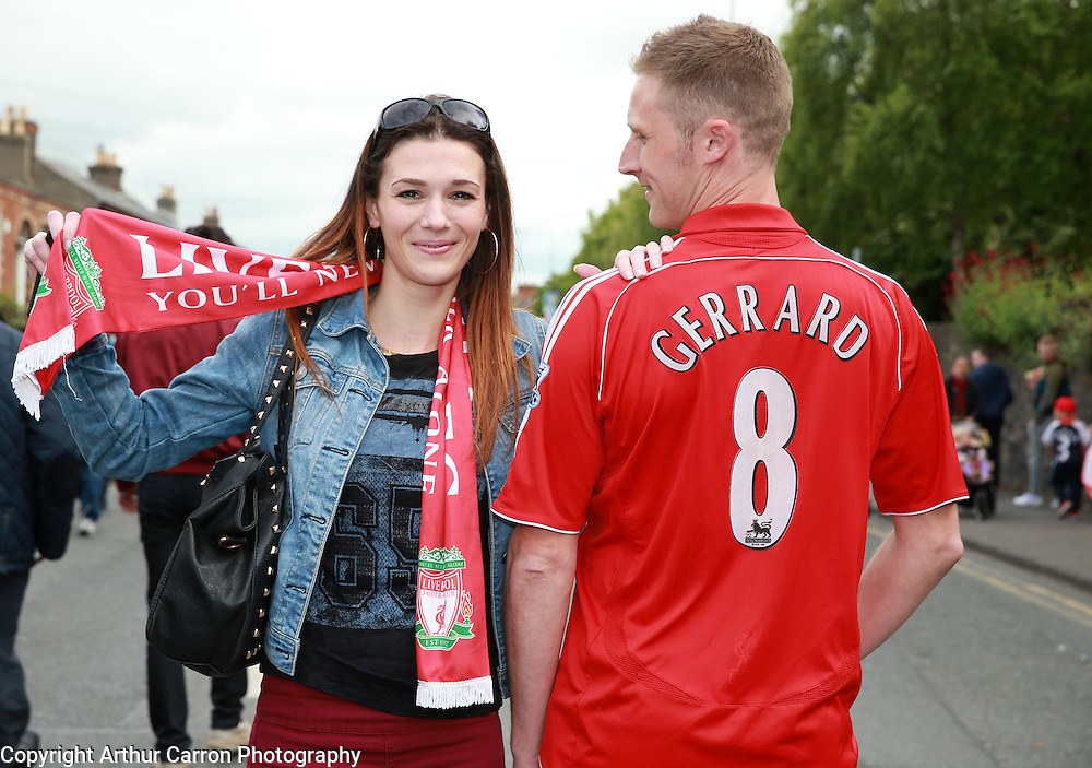 14/5/14 Fans Emma Rice and Luke McCoy, Wicklow on their way to see the friendly game between Liverpool FC and Shamrock Rovers at the Aviva stadium in Dublin. Picture:Arthur Carron