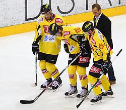 08.01.2012, Albert Schultz Halle, Wien, AUT, EBEL, UPC Vienna Capitals vs Moser Medical Graz 99ers, im Bild Peter Casparsson, (UPC Vienna Capitals, #20) und Daniel Nageler, (UPC Vienna Capitals, #16) helfen Marcel Rodman, (UPC Vienna Capitals, #22) vom Eis // during the icehockey match of EBEL between UPC Vienna Capitals (AUT) and Moser Medical Graz 99ers (AUT) at Albert Schultz Halle, Vienna, Austria on 08/01/2012, EXPA Pictures © 2012, PhotoCredit: EXPA/ T. Haumer