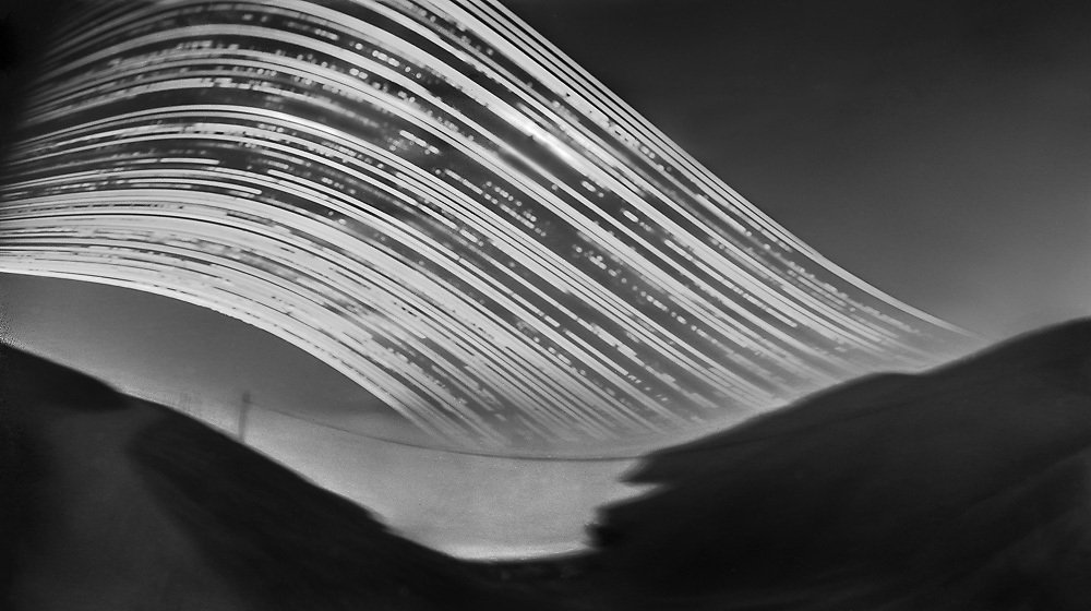 """Summit Road; above Taylors Mistake.<br /> 2016 (6 months pinhole exposure).<br /> 140mm x 250mm (image size).<br /> Pigment ink on paper.<br /> Editions of 5. First shown at the exhibition """"Art for Art"""" at the Christchurch Art Gallery Te Puna o Waiwhetū (2017)."""