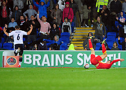 Wales Gareth Bale (Tottenham)  goes down under the challenge of Scotland's Shaun Maloney (Wigan) to win a penalty - Photo mandatory by-line: Joe Meredith/JMP  - Tel: Mobile:07966 386802 12/10/2012 - Wales v Scotland - SPORT - FOOTBALL - World Cup Qualifier -  Cardiff   - Cardiff City Stadium -