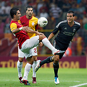 Galatasaray's Arda TURAN (L) during their Friendly soccer match Galatasaray between Liverpool at the TT Arena at Arslantepe in Istanbul Turkey on Saturday 28 July 2011. Photo by TURKPIX