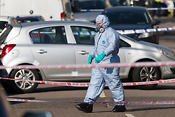 © Licensed to London News Pictures. 23/02/2019. London, UK.  Forensic officers investigating the crime scene at Vincent Road, Wood Green in Haringey. Police were called to Vincent Road last night to reports of a group of people fighting, where two men believed to be aged 19 and 20 were found with stab injuries. The injured men were taken to hospital and the 19 year old who was also found to have suffered gun shot wounds was pronounced dead shortly after 3am.  Photo credit: Vickie Flores/LNP
