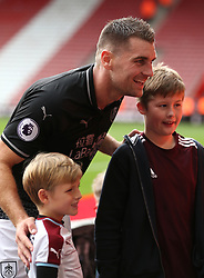 Burnley's Sam Vokes (centre) poses with fans after the final whistle