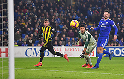 Watford's Gerard Deulofeu (left) scores his side's third goal of the game during the Premier League match at the Cardiff City Stadium.