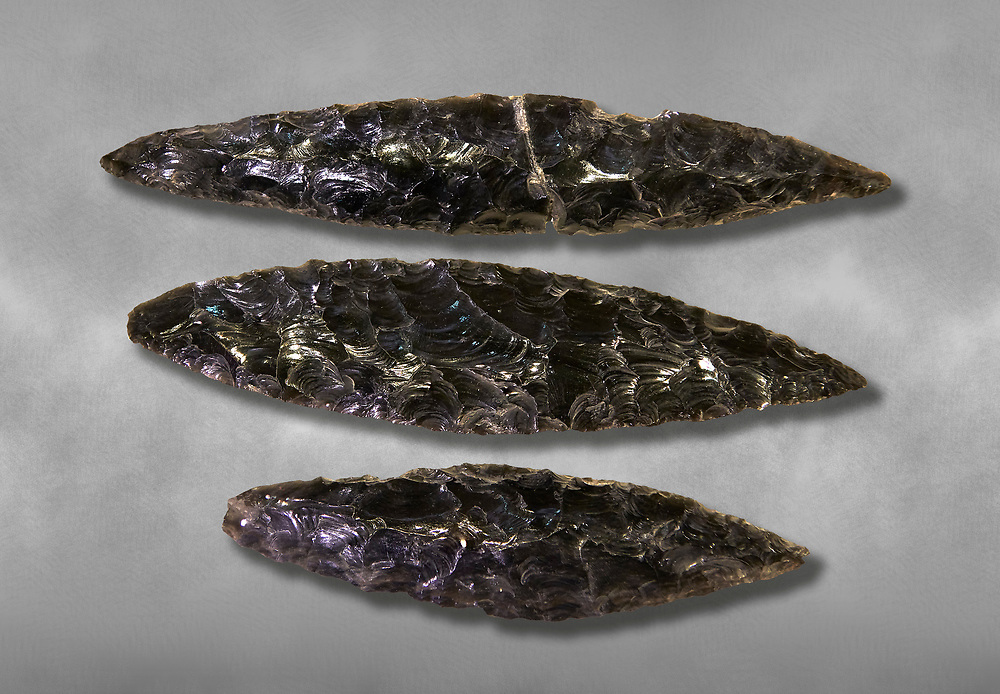 Black obsidian blades. Catalhoyuk Collections. Museum of Anatolian Civilisations, Ankara. Against a gray mottled background .<br /> <br /> If you prefer you can also buy from our ALAMY PHOTO LIBRARY  Collection visit : https://www.alamy.com/portfolio/paul-williams-funkystock/prehistoric-neolithic-art.html - Type Catalhoyuk into the LOWER SEARCH WITHIN GALLERY box. Refine search by adding background colour, place, museum etc.<br /> <br /> Visit our PREHISTORIC PLACES PHOTO COLLECTIONS for more  photos to download or buy as prints https://funkystock.photoshelter.com/gallery-collection/Prehistoric-Neolithic-Sites-Art-Artefacts-Pictures-Photos/C0000tfxw63zrUT4