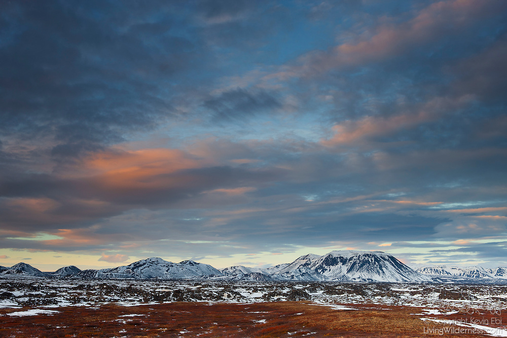 Several tall mountains stand over the ancient lava flow Búrfells-hraun in northern Iceland. Geologists believe a large lava lake formed here and then collapsed, releasing a flood of lava. Pieces of the lava crust flowed as much as 10 km (6.2 miles) downstream.