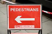Red arrow pedestrians sign