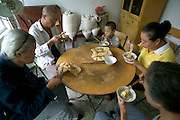 (MODEL RELEASED IMAGE). Breakfast at the Cuis' includes fresh eggs from the family hens and hot mian tiao (noodles) with a little cooked spinach and MSG. (Supporting image from the project Hungry Planet: What the World Eats.) The Cui family of Weitaiwu village, Beijing Province, China, is one of the thirty families featured, with a weeks' worth of food, in the book Hungry Planet: What the World Eats.