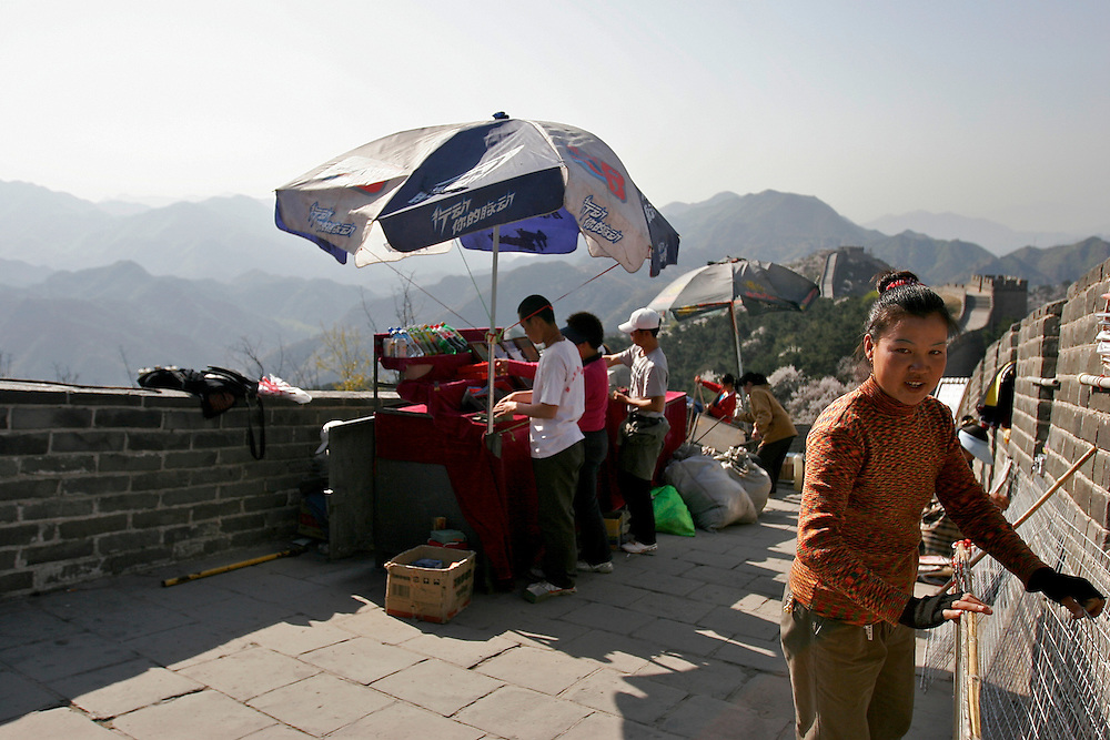 Vendors begin to set up during the morning along the top of the Great Wall at Badaling in China.