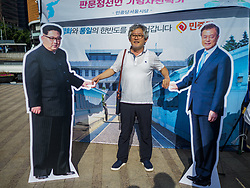 June 15, 2018 - Seoul, Gyeonggi, South Korea - A man stands between cardboard cutouts of North Korean leader Kim Jong-un (left) and South Korean President Moon Jae-in during a rally to mark the anniversary of the signing of the June 15th North–South Joint Declaration between South Korea and North Korea. The Declaration was negotiated by late South Korean President Kim Dae-jung and North Korean leader Kim Jong-il and signed on 15 June 2000. It was a part of South Korea's ''Sunshine Policy,'' which guides the South's relationship with North Korea. This year's observance of the anniversary was bolstered by the recent thawing in relations between North Korea and South Korea and the US. (Credit Image: © Jack Kurtz via ZUMA Wire)