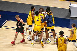 Jan 25, 2021; Morgantown, West Virginia, USA; West Virginia Mountaineers players celebrate with West Virginia Mountaineers guard Miles McBride (4) as his late second half basket beats the Texas Tech Red Raiders at WVU Coliseum. Mandatory Credit: Ben Queen-USA TODAY Sports
