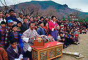 Musicians and spectators at dance and archery festival, Paro, Bhutan
