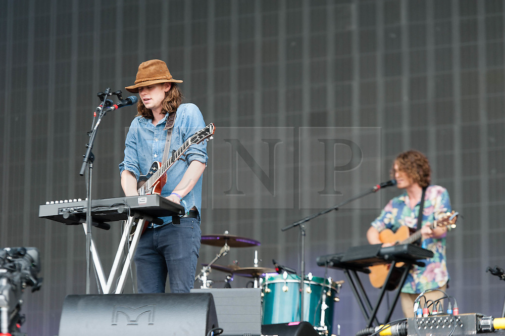 © Licensed to London News Pictures. 12/07/2014. London, UK.   Half Moon Run performing live at Hyde Park as part of the British Summer Time series of outdoor concerts.   In this picture - Conner Molander (left), Isaac Symonds (right). Half Moon Run are a Canadian indie rock band  consisting of members Devon Portielje (vocals/guitar), Dylan Phillips (vocals/drums), Conner Molander (guitar/keyboard/vocals), and Isaac Symonds (vocals/percussion/mandolin/keyboard/guitar).  Photo credit : Richard Isaac/LNP