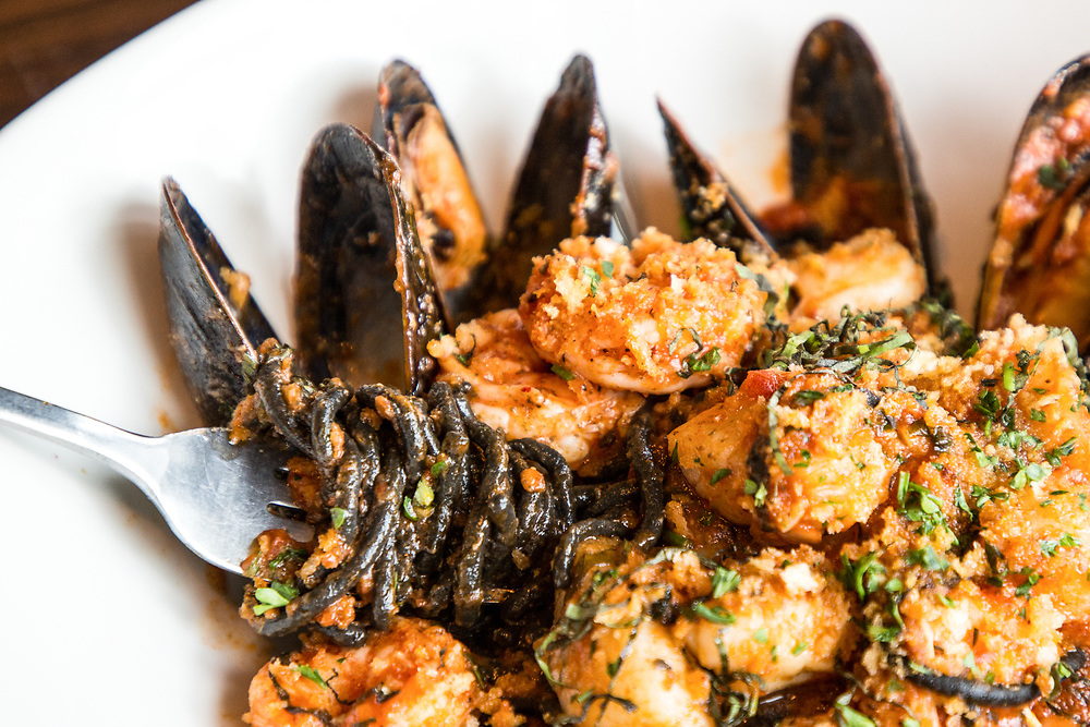 A close-up of the Black Spaghetti entree featuring scallops, mussels, shrimp, and white wine pomodoro served at Johnny's Tavern located at 30 Boltwood Walk in Amherst on July 25, 2018. (Chris Marion / The Republican)