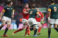 Duane Vermeulen of South Africa grabs Alex Cuthbert of Wales by the throat. Rugby World Cup 2015 quarter final match, South Africa v Wales at Twickenham Stadium in London, England  on Saturday 17th October 2015.<br /> pic by  John Patrick Fletcher, Andrew Orchard sports photography.