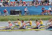 Eton Dorney, Windsor, Great Britain,..2012 London Olympic Regatta, Dorney Lake. Eton Rowing Centre, Berkshire[ Rowing]..Gold medalist, GBR M4-   Bow Alex GREGORY, Peter REED, Tom JAMES and Andy TRIGGS HODGE, qualify for the final of  Men's Four.  AUS M4- Background William LOCKWOOD (b) , James CHAPMAN (2) , Drew GINN (3) , Joshua DUNKLEY-SMITH (s)Dorney Lake. 10:15:53  Thursday  02/08/2012   [Mandatory Credit: Peter Spurrier/Intersport Images]  .