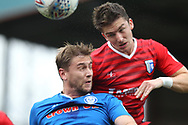 Steven Davies challenges for the ball during the EFL Sky Bet League 1 match between Rochdale and Gillingham at Spotland, Rochdale, England on 23 September 2017. Photo by Daniel Youngs.