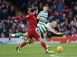 Celtic's Scott Brown is brought down by Aberdeen's Stevie May during the Scottish Premiership match at Pittodrie Stadium, Aberdeen.
