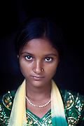 (name changed) Kanchan Kumari Sharma, 12, is standing insider her home in Sersiya Kekrahi village, Varanasi District, Uttar Pradesh, India. In 2012, Kanchan went with a friend to bring lunch to her father, around 2 km away from her home. On the way they met Rajesh (rapist) and Ashok, a friend of his. Both girls were picked up on the spot using an excuse. Ashok drove Kanchan's friend home, but Rajesh forced Kanchan to travel with him during six days and for hundreds of kilometres across different states. (Mirzapur / Chennai / Itarsi / Bhusawal) He raped her once behind the station in Itarsi. With great effort and some coincidence, the uncle of Kanchan managed to bring her back home. Although she was scared, she insisted on going to the police to file a case (FIR). She was kept at the police station for 12 days and threatened to prevent her from filing an official case. Ashok and Rajesh are from higher caste and wealthy families. While Rajesh spent 24 days in jail initially in summer 2012, he is now a free man while the trial is still going on. Kanchan's family is now struggling to put together 30.000 Indian Rupees (500 USD) to continue battling for justice in court.