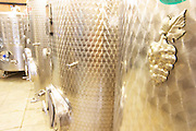 The winery with modern stainless steel fermentation tanks. Detail of grape bunch decoration. Toreta Vinarija Winery in Smokvica village on Korcula island. Vinarija Toreta Winery, Smokvica town. Peljesac peninsula. Dalmatian Coast, Croatia, Europe.