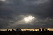 Heavenly shaft of light breaking through clouds. London, UK.