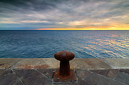 A rusty cleat at the small harbour of Vernazza, one of the five Ligurian villages known as Cinque Terre. Taken a few minutes before sunset on a windy evening at the beginning of February.
