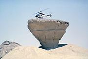 Bell 206 JetRanger helicopter landed on rock outcrop Arabian desert, Saudi Arabia oil industry 1979