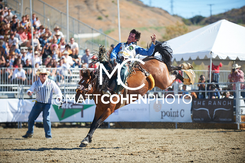 Bareback rider Richmond Champion of The Woodlands, TX rides 044 Nitty Gritty at the Rancho Mission Viejo Rodeo in San Juan Capistrano, CA.<br /> <br /> <br /> UNEDITED LOW-RES PREVIEW<br /> <br /> <br /> File shown may be an unedited low resolution version used as a proof only. All prints are 100% guaranteed for quality. Sizes 8x10+ come with a version for personal social media. I am currently not selling downloads for commercial/brand use.