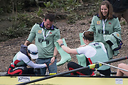 Greater London. United Kingdom, James LEE, helps the Cox and Stroke out of the boat after the Women'sUniversity Boat Race , Cambridge University vs Oxford University. Putney to Mortlake,  Championship Course, River Thames, London. <br /> <br /> Saturday  24.03.18<br /> <br /> [Mandatory Credit  Intersport Images]