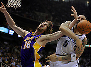 The Lakers' Pau Gasol is fouled by Utah's Carlos Boozer during the first half Saturday...///ADDITIONAL INFO:  lakers.0426.kjs2.jpg  ---  Photo by Kevin Sullivan, The Orange County Register --  ..The Los Angeles Lakers take on the Utah Jazz in Game 4 of the Western Conference Playoffs at EnergySolutions Arena in Salt Lake City, Utah...Photographed Saturday April 25, 2009..