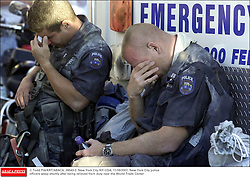 © Todd Pitt/KRT/ABACA. 28543-2. New York City-NY-USA, 11/09/2001. New York City police officers weep shortly after being relieved from duty near the World Trade Center  | 28543_02
