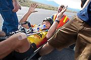 Sergey Dashevskey is blij dat hij is gefinished op de vijfde racedag van de WHPSC. In Battle Mountain (Nevada) wordt ieder jaar de World Human Powered Speed Challenge gehouden. Tijdens deze wedstrijd wordt geprobeerd zo hard mogelijk te fietsen op pure menskracht. Ze halen snelheden tot 133 km/h. De deelnemers bestaan zowel uit teams van universiteiten als uit hobbyisten. Met de gestroomlijnde fietsen willen ze laten zien wat mogelijk is met menskracht. De speciale ligfietsen kunnen gezien worden als de Formule 1 van het fietsen. De kennis die wordt opgedaan wordt ook gebruikt om duurzaam vervoer verder te ontwikkelen.<br /> <br /> A happy Sergey Dashevskey at the finish of the fifth day if the WHPSC. In Battle Mountain (Nevada) each year the World Human Powered Speed Challenge is held. During this race they try to ride on pure manpower as hard as possible. Speeds up to 133 km/h are reached. The participants consist of both teams from universities and from hobbyists. With the sleek bikes they want to show what is possible with human power. The special recumbent bicycles can be seen as the Formula 1 of the bicycle. The knowledge gained is also used to develop sustainable transport.