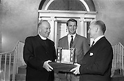 22/08/1966<br /> 08/28/1966<br /> 22 August 1966<br /> Blackrock College R.F.C. press conference at Stradbrook Road, Blackrock, Dublin. To announce the First ever Festival of Rugby at Blackrock College to be played on the 11 September 1966 on the Club's new grounds, the trophy was donated by Blackrock College. . Picture shows Very Rev. Tim O'Driscoll, C.S.Sp., (left) President of Blackrock College handing over the new trophy for the Festival to Mr. J. Sadleir, (right) President of Blackrock College R.F.C., at the reception at the new grounds. Centre is Mr. N.H. Brophy, Club Captain (1966/67).