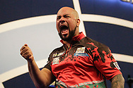 Devon Petersen beats his chest after winning a very close game that went to the very final leg, during the World Championship Darts 2018 at Alexandra Palace, London, United Kingdom on 17 December 2018.