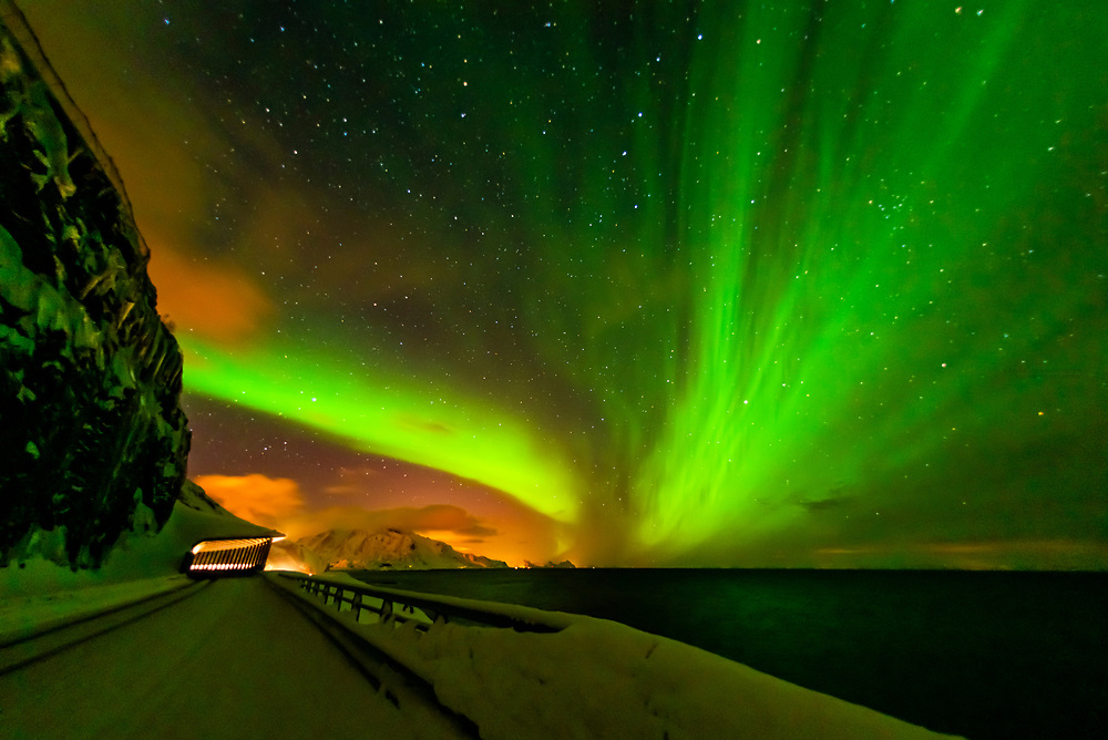 Northern Lights (Aurora Borealis) seen from along the E10 near Reine, Moskenoesoya Island, Lofoten Islands, Arctic, Northern Norway.
