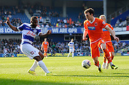 Queens Park Rangers Junior Hoilet passing the ball past Blackpool's Jack Robinson. Skybet football league championship match , Queens Park Rangers v Blackpool at Loftus Road in London  on Saturday 29th March 2014.<br /> pic by John Fletcher, Andrew Orchard sports photography.