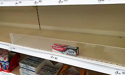 "© Licensed to London News Pictures. 24/09/2020. London, UK. A box of Colgate toothpaste on a virtually empty shelf of in Wilko supermarket in London, as essential items start to run out, amid a possible second lockdown due to a rise in COVID-19 cases. Foreign Secretary, DOMINIC RAAB has said that, a second national lockdown could be needed if the latest coronavirus restrictions do not work but the government will ""take every effort to avoid that"". Photo credit: Dinendra Haria/LNP"