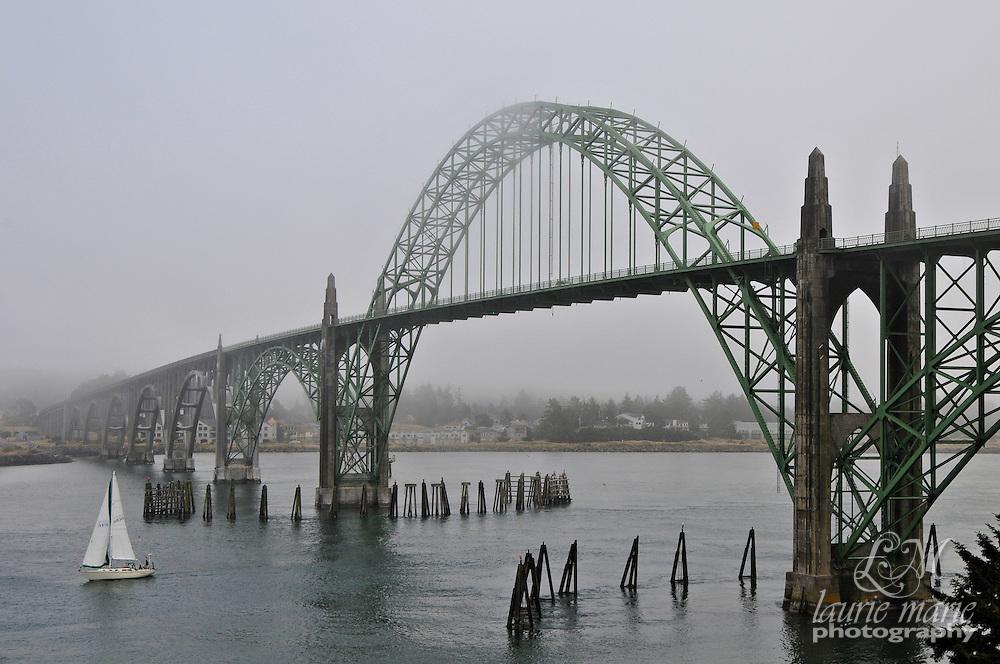 Yaquina Bay Bridge on a foggy day over Yaquina Bay in Newport, Oregon Coast