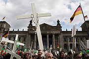 "Participants in ""The March For Life"" are seen carrying crosses as they march in front of the Bundestag in Berlin's Mitte district, on September 16, 2017. In the center of the pro-life event was the call by the organizers for German politicians and society to take active action against a ""silent increase of acceptance"" of the phenomenon. Abortion in Germany is permitted in the first trimester of the pregnancy, with the condition of mandatory counseling and in a later period of the pregnancy in cases of medical necessity.<br /> (Photo by Omer Messinger)"