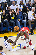 Fans react to Golden State Warriors forward Draymond Green (23) and Houston Rockets forward PJ Tucker (4) colliding at Oracle Arena in Oakland, Calif., on October 17, 2017. (Stan Olszewski/Special to S.F. Examiner)