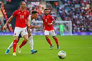 Anton Nedyalkov of Bulgaria blocks the path of Jason Sancho of England during the UEFA European 2020 Qualifier match between England and Bulgaria at Wembley Stadium, London, England on 7 September 2019.