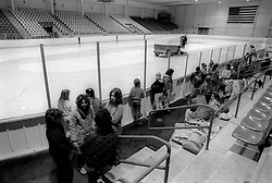 Unidentified skaters wait for a Zamboni to finish resurfacing the ice rink at Mennen Arena in Morris Plains, N.J., Thursday, Feb. 13, 1986. (D. Ross Cameron/North Jersey Advance)